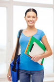 Student with folders, tablet pc and bag at school — Stock Photo