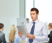Buisnessman with tablet pc at office — Stock Photo