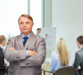 Serious businessman or teacher in suit at office — Stock Photo