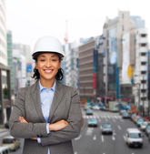 Businesswoman in white helmet with crossed arms — Stock Photo