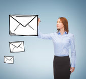 Businesswoman drawing envelope on virtual screen — Stock Photo