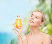 Lovely woman with oil bottle — Foto Stock
