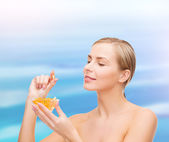 Lovely woman with omega 3 vitamins — Stock Photo