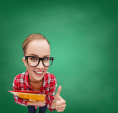 Student in glasses with folders showing thumbs up — Stok fotoğraf