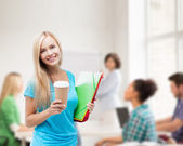 Smiling student with folders — Stockfoto