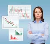 Smiling businesswoman with crossed arms — Stock Photo