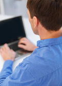 Close up of man with laptop computer — Stock Photo
