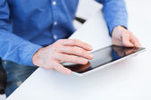 Close up of male hands working with tablet pc — Stock Photo