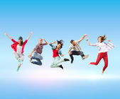 Group of teenagers jumping — Stockfoto