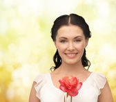 Young and beautiful woman with flower — Foto de Stock