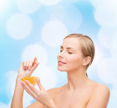 Lovely woman with omega 3 vitamins — Foto Stock
