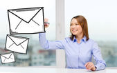 Businesswoman drawing envelope — Stock Photo