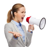 Angry businesswoman with megaphone — Stock Photo