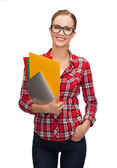 Female in eyeglasses with folders and tablet pc — Stock Photo