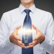 Buisnessman holding something in his hands — Stock Photo