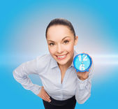Smiling businesswoman with blue clock — Zdjęcie stockowe