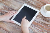 Female pointing finger to tablet pc screen — Stock Photo