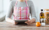 Closeup of woman reading recipe from tablet pc — Stock Photo