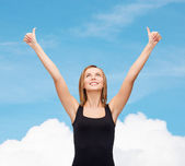 Woman in blank black tank top showing thumbs up — Stock Photo