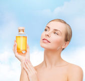Lovely woman with oil bottle — Stock Photo