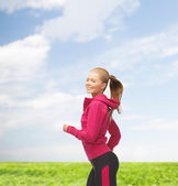 Sporty woman running or jumping — Stockfoto