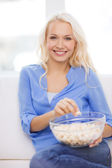 Young girl with popcorn ready to watch movie — Stock Photo