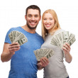 Smiling couple holding dollar cash money — Stock Photo #41578587