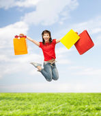 Excited girl with shopping bags — Stock Photo