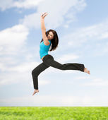 Sporty woman jumping in sportswear — Stok fotoğraf