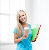 Smiling student with folders — Stok fotoğraf