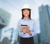 Young smiling businesswoman in white helmet — Stock Photo