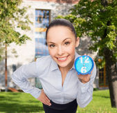 Smiling businesswoman with blue clock — Stok fotoğraf