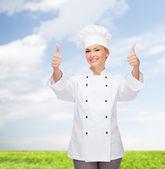 Chef mujer sonriente mostrando los pulgares para arriba — Foto de Stock