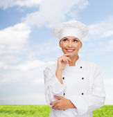 Smiling female chef dreaming — Photo