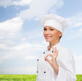 Smiling female chef showing ok hand sign — Stok fotoğraf