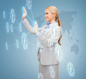 Smiling businesswoman working with virtual screen — Stock Photo