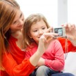 Stock Photo: Smiling mother and daughter taking picture