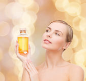 Lovely woman with oil bottle — Stockfoto