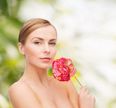 Lovely woman with peonie flower — Foto Stock
