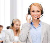 Friendly female helpline operator at office — Stock Photo