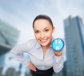 Smiling businesswoman with blue clock — ストック写真