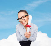 Smiling businesswoman in eyeglasses with diploma — Stock Photo