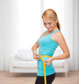 Sporty woman with measuring tape — Foto de Stock