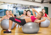 Smiling female instructor with fitness ball — Stock Photo