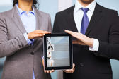Businessman and businesswoman with tablet pc — Stok fotoğraf
