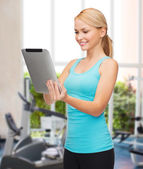 Sporty woman with tablet pc — Foto de Stock