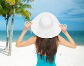 Woman sitting in swimsuit with hat — Foto de Stock