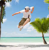Male dancer jumping in the air — Stock Photo