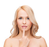 Woman touching her lips — Stockfoto