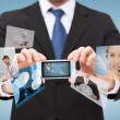 Stock Photo: Businessmwith smartphone and news on screen